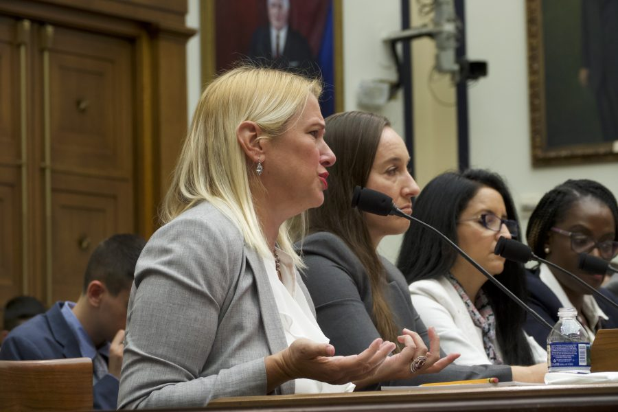 Kate Ranta, testifying about domestic violence in the military she endured before the House Armed Services Subcommittee on Military Personnel. (Miranda Mahmud/Gaylord News)