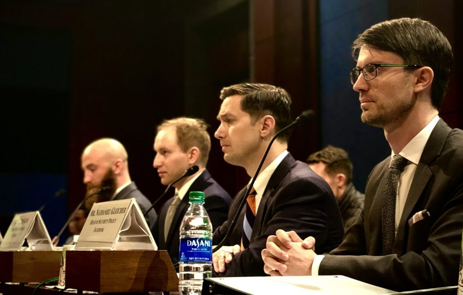 Four representatives from Vietnam Veterans of America, Graphika, Twitter and Facebook testifying before the Committee on Veterans' Affairs about veteran exploitation on social media.
