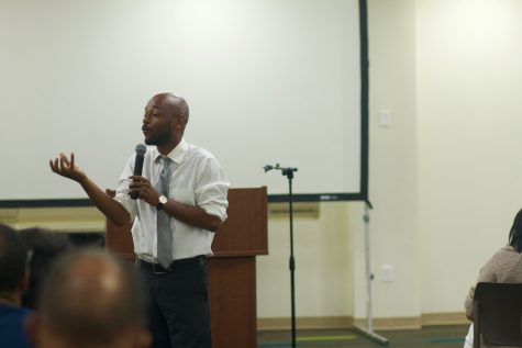 Rev. Michael Wortham, College and Young Adult Pastor, presents a message on faith and politics at the mid-week service.