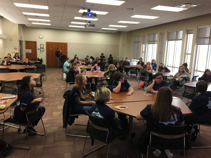 Participants listen to guest speaker in a classroom at the ExxonMobil Lawerence G. Rawl Engineering Facility.