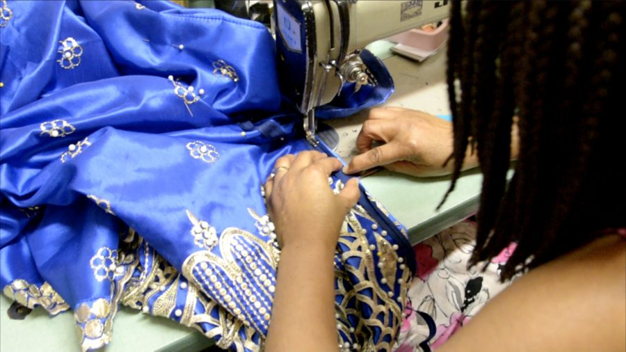 Betty is working on her latest project, a royal blue gown for a customer graduating from medical school. Photo by Rebecca Walters.