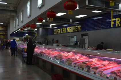 Super Cao Nguyen customers survey the food options that the market has to offer. Abby Green/News Crowd