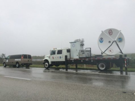 Two of the three vehicles the group of meteorologists took sit on the side of the road in Fort Lauderdale, Florida during Hurricane Irma. Photo provided by Mike Biggerstaff.