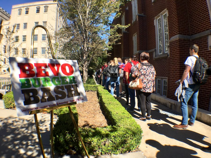 "OU students, faculty and staff waiting in line in the Oklahoma Memorial Union Courtyard for the Union Programming Board's event, ""Bevo Burger Bash""."