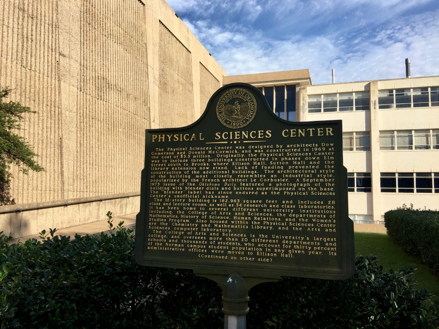 A plaque in front of the 50-year-old Physical Sciences Center at the University of Oklahoma.