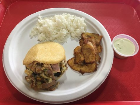 An arepa served with fried plantains and rice.