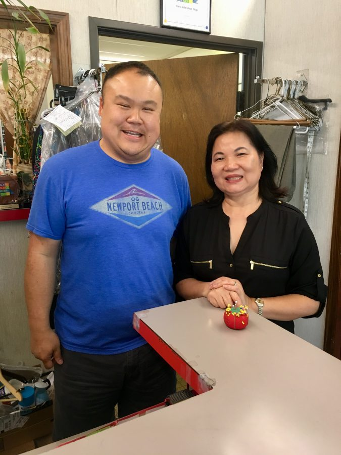 Kim's Alterations, Inc. owner Kim Lu and her son Dennis Lu pose inside Lu's alterations shop of 34 years.