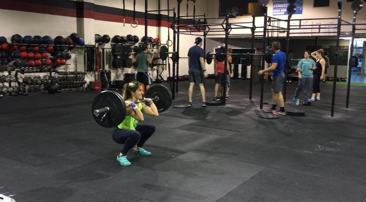 Customers get a workout in during one of the afternoon classes at Koda CrossFit Norman.
