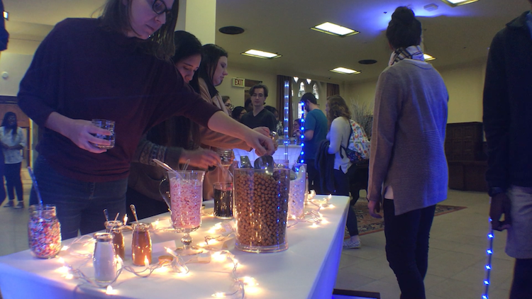 University of Oklahoma students top up their cocoa during an event held yesterday in the Oklahoma Memorial Union.