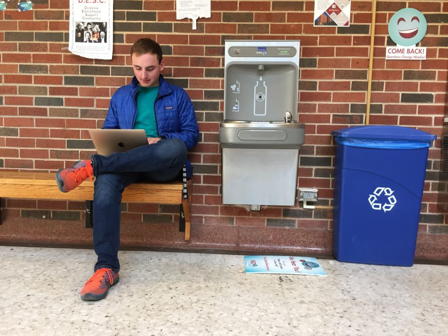 An OU student studies next to one of the six water refill stations in Dale Hall.