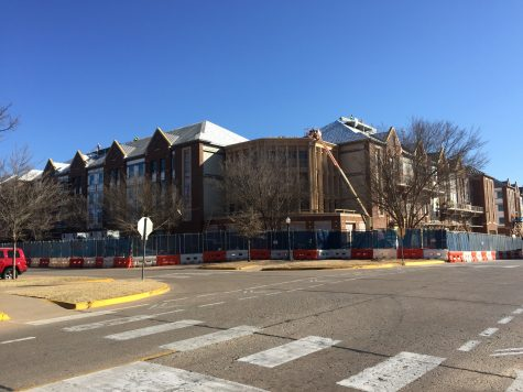 Construction workers reach the final stage in the development of Cross OU. The complex will contain a black box theatre, a coffee shop and multiple retail shops.