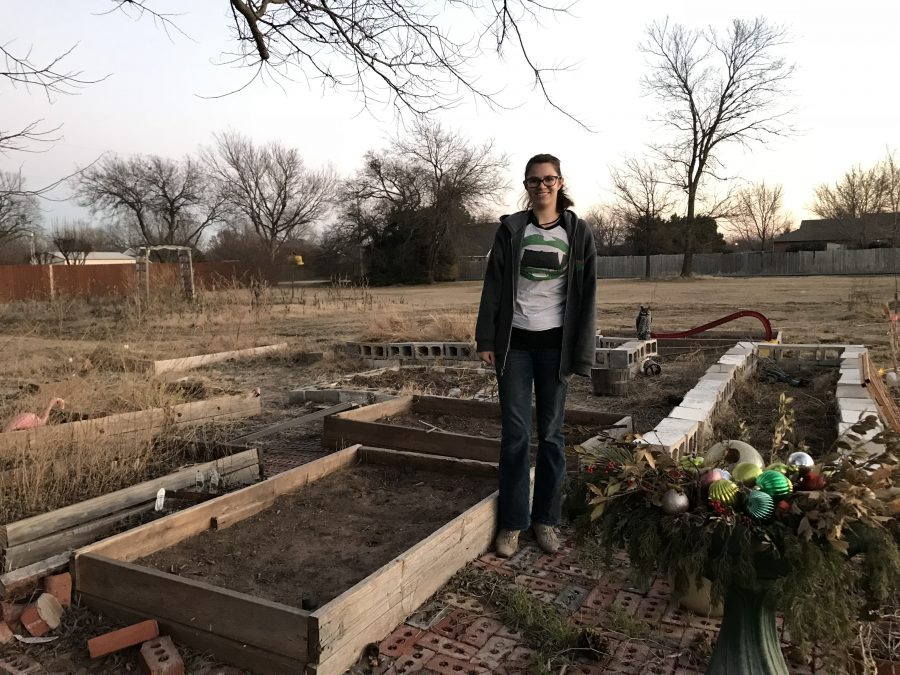 Elizabeth Guthrie stands amongst her raised garden beds in Newcastle.