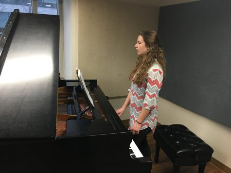 Music education sophomore Bryla Birdwell does voice exercises in Donald W. Reynolds Performing Arts Center. Birdwell pays over $250 a semester for instrumental accompaniment.