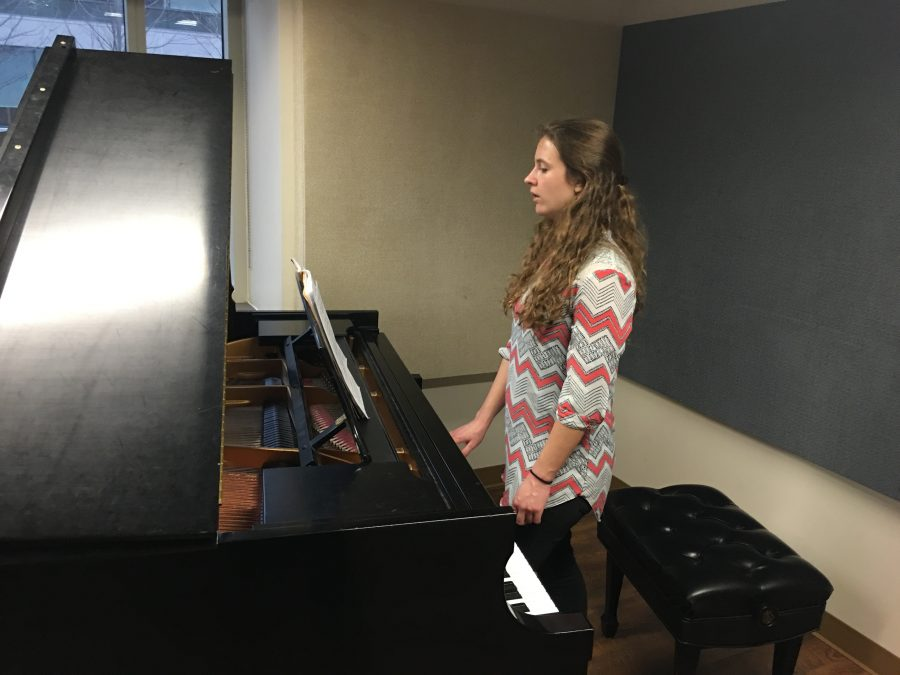 Music+education+sophomore+Bryla+Birdwell+does+voice+exercises+in+Donald+W.+Reynolds+Performing+Arts+Center.+Birdwell+pays+over+%24250+a+semester+for+instrumental+accompaniment.