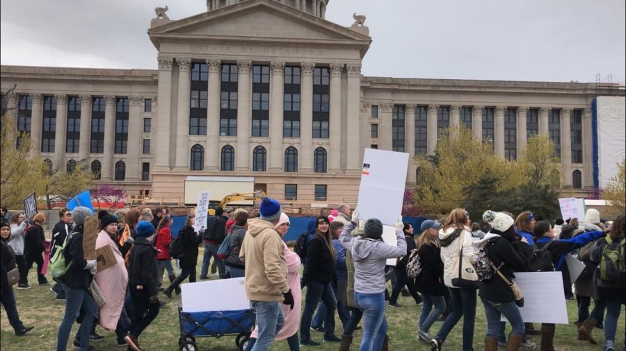 Teachers and college students studying education participate in a walkout in front of the Oklahoma State Capitol in Oklahoma City April 2.