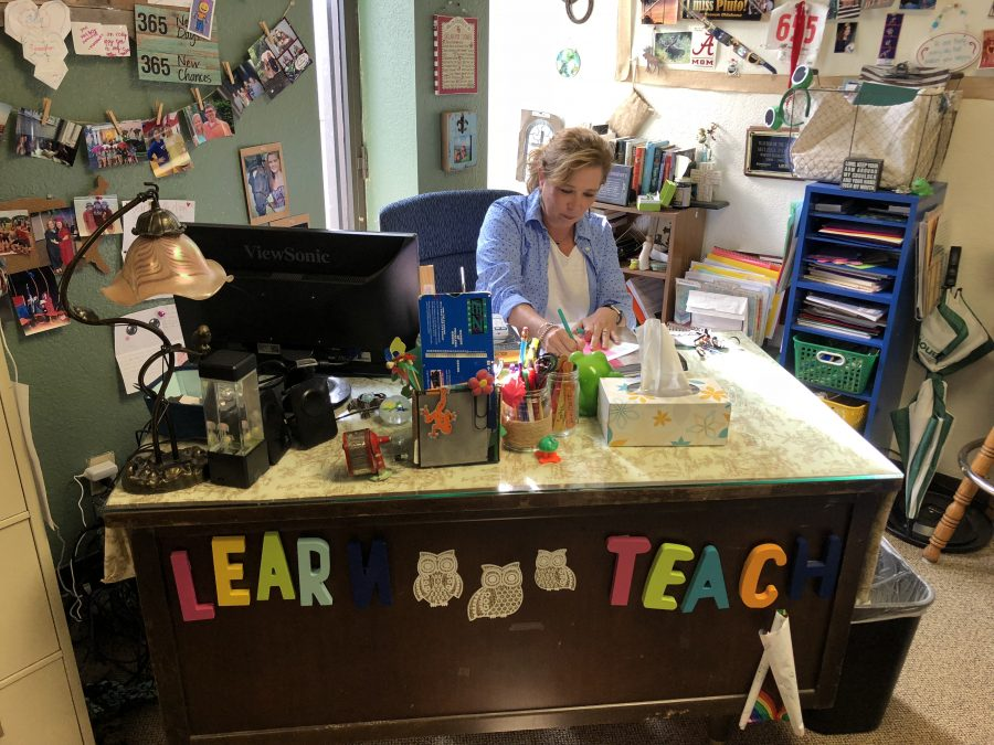 Fifth-grade teacher Melissa Nelson prepares lessons for her class at Oklahoma Christian School, a private school, in Edmond, Oklahoma.
