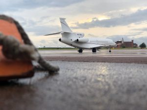 Incoming Jets: A parked private jet sits on the tarmac of Norman's Max Westheimer Airport. Over 20 jets arrived at the airport during OU's football game with UCLA last weekend. Photo by Brandon King.