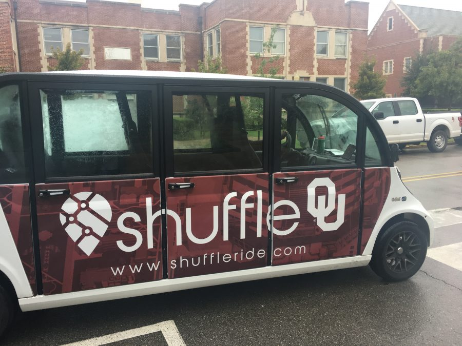 A driver parks a Shuffle vehicle by the University of Oklahoma student union. Shuffle is a new transportation service that allows students to pay $3 to ride to places on or near campus.