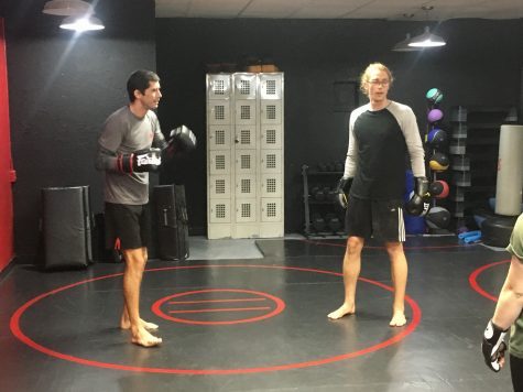 James White, owner of James White Fitness (left), and Austin Plank, a director of Second Wind Coffeehouse (right), perform Muay Thai combinations at a Nov. 15 session for Second Wind baristas. White is a former mixed martial arts fighter who offers free Muay Thai lessons to Second Wind baristas at 6 p.m. every Thursday.