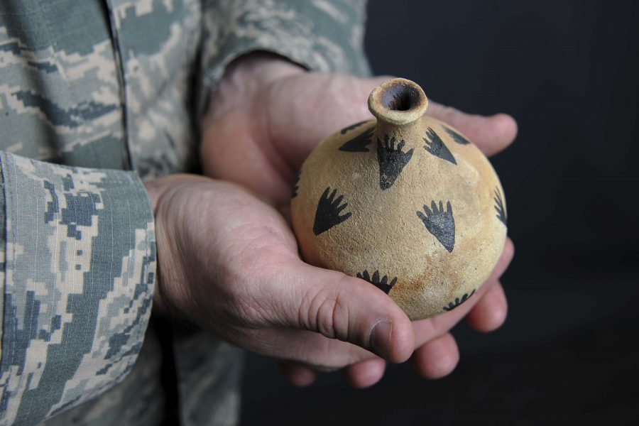 Capt. Travis Trueblood, 11th Wing assistant staff judge advocate, holds a piece of pottery at Joint Base Andrews, Md., Nov. 16, 2017. The pottery was gifted to Trueblood by a member of the Choctaw and Seminole Nations during a speech he gave about federal American Indian law at a the University of Florida for the 2016 National American Indian Heritage Month. (U.S. Air Force photo by Airman Michael Murphy)