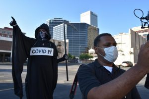 Oklahoma Eagle photojournalist C.J. Neal films a stand-up outside the BOK Center where President Trump is speaking. Photo by Wendy Weitzel/Gaylord News.