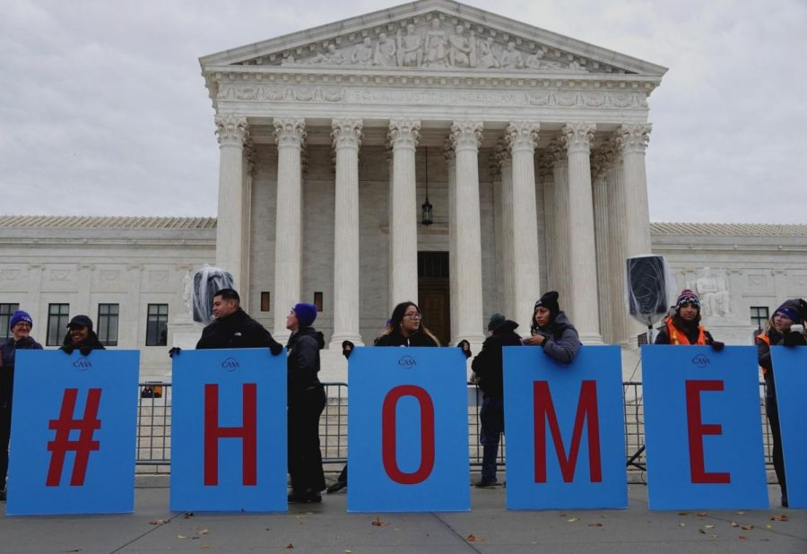 Dozens of individuals hold signs in front of the U.S. Supreme Court on Nov. 12, as a crowd advocates for justices to uphold the Obama-era DACA program. Addison Kliewer/Gaylord News.