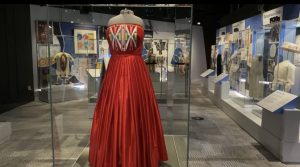 Caption 1 Dress: Isabella Aiukli Cornell's 2018 prom dress on display in Smithsonian Girlhood exhibit.  (Gaylord News/Emma Sears)