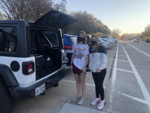Alyssa Landry, left, and Alexis Martinez prepare to leave the University of Oklahoma for Thanksgiving break.  Zaria Oates/Gaylord News