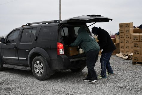 Oklahoma Kiowa Tribe volunteers load free food into a recipient's car after severe weather conditions hit the state. (Photo courtesy the Kiowa Tribe)