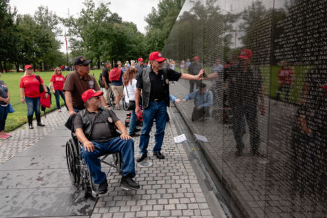 S. Joe Crittenden, Deputy Principal Chief of the Cherokee Nation, places a hand on the wall of the Vietnam Veterans Memorial. (Megan Ross / Gaylord News)