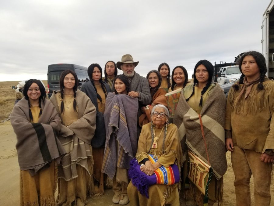 Tom Hanks gets his picture with the Kiowa cast and Dorothy WhiteHorse DeLaune from the film