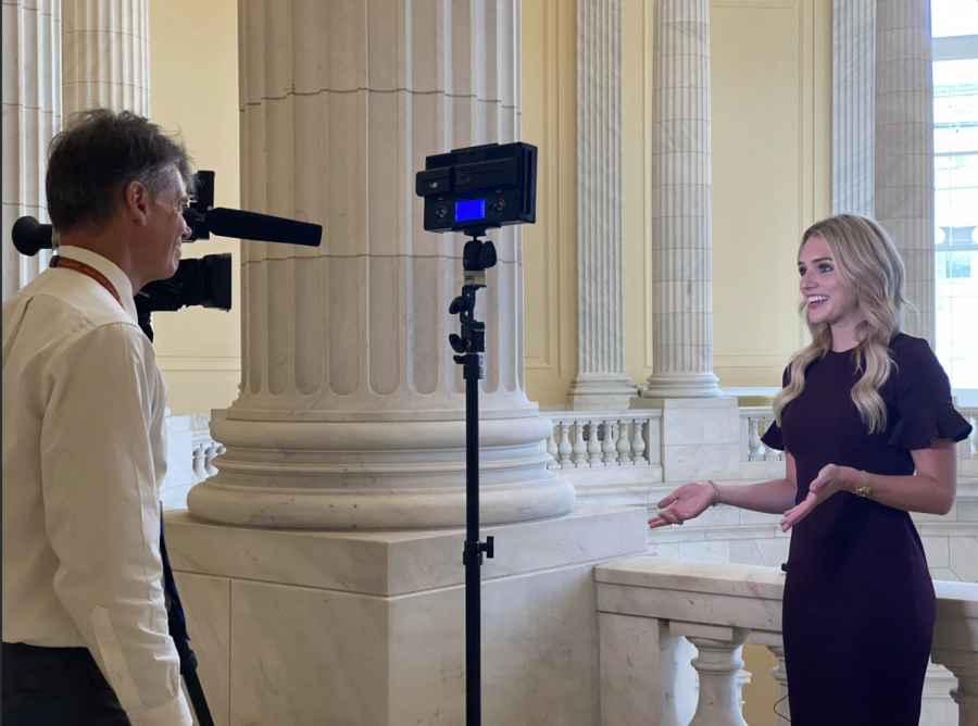 Alex Cameron, Washington D.C. correspondent of News 9, interviews Gaylord News reporter Libbey Dean in the Cannon Rotunda. (Gaylord News/ Vy Luong)
