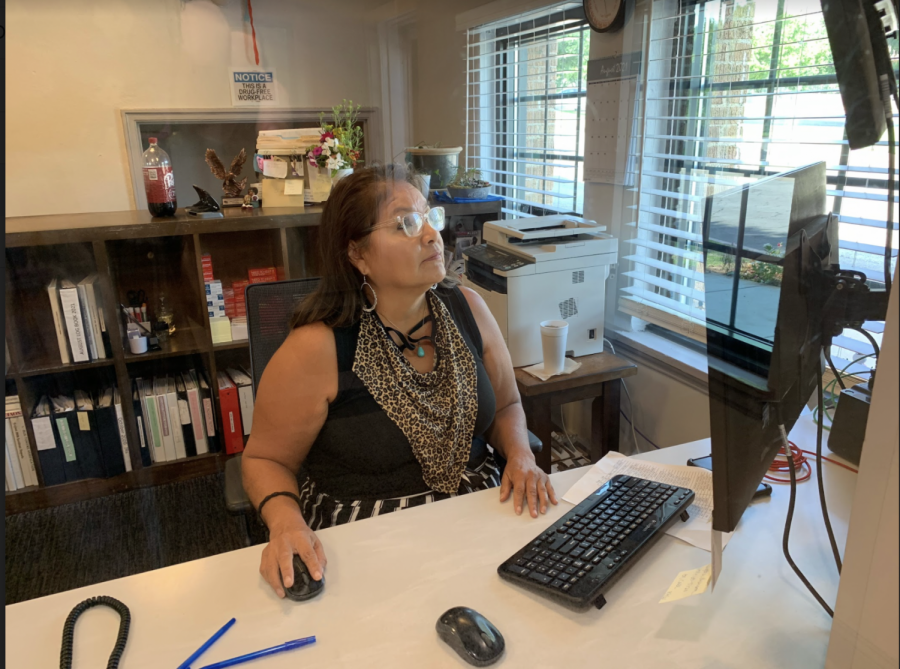 Kim Holmes at work in her office at the Altamont Apartment complex in Tulsa where she works as a property manager for the Mental Health Association of Oklahoma. Gaylord News photo / John Gott