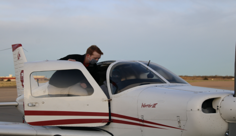 Field Parsons stands on an aircraft at the Max Westheimer airport on March 24. (Gaylord News/ Zaria Oates)