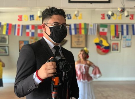 Kevin Palomino on assignment for a story for Hispanic Heritage Month at Clips and Hips, a bilingual dance studio and hair salon in Oklahoma City. (Gaylord News/Pamela Ortega)