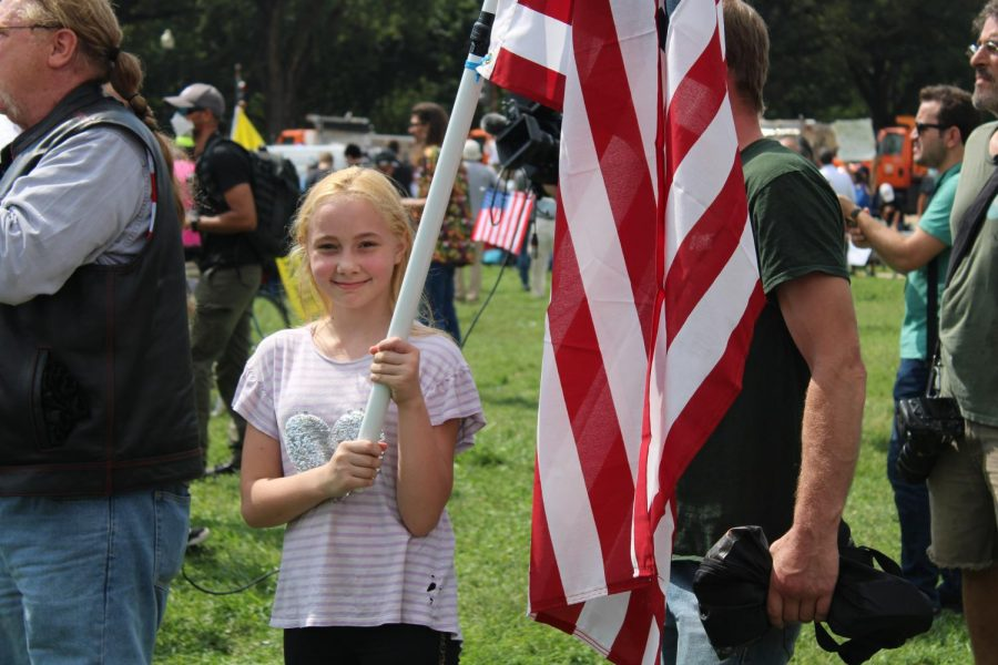 - A child holds United States flag while attending the Justice for J6 rally at the U.S. Capitol on Saturday, Sept. 18. (Gaylord News/ Zaria Oates)