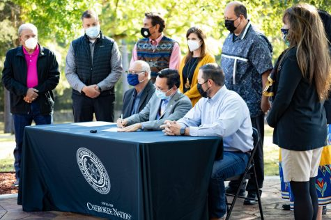 Cherokee Nation Principal Chief Chuck Hoskin Jr.,Cherokee Nation Deputy Principal Chief Bryan Warner and other Cherokee Nation leaders including the tribe's Language Department gather at Sequoyahs Cabin Museum to sign the Sequoyah Day proclamation. (Provided)