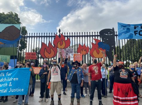 Indigenous environmental activists and allies protest in front of the White House at the People Vs. Fossil Fuels rally. (Robert Viamontes/Gaylord News)